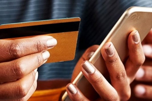 Credit card and mobile phone in hands